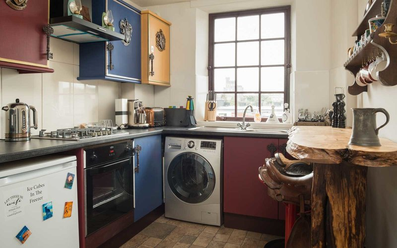 The flat is full of Harry Potter themed accessories. See Centre Press story CPPOTTER; Harry Potter fans now have the chance to spend a night at Hogwarts -- after a luxury apartment dedicated to the much-loved films opened to visitors. Situated in the Scottish Capital -- the birthplace of J.K Rowling's Harry Potter books -- the magical apartment is the brainchild of Hogwarts superfan Yue Gao. Canongate Luxury Apartment, which overlooks Edinburgh's Royal Mile, has a master bedroom with a Gryffindor dormitory theme. The flat, which is available to rent all year round, comes with a four-poster bed and has a ceiling which makes a beautiful illusion of floating candles. A second, smaller double room has been decked out to look like a carriage from the Hogwarts Express.