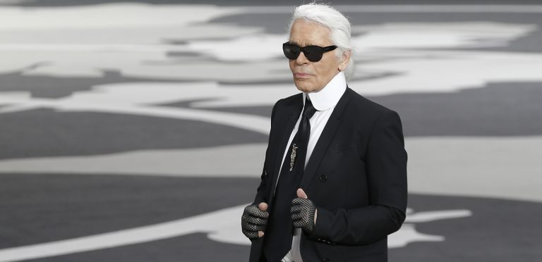 FILE - A Tuesday, March, 5, 2013 photo of German fashion designer Karl Lagerfeld acknowledging applause at the end of his Fall/Winter 2013-2014 ready to wear collection for Chanel presented in Paris. Chanel's iconic couturier, Karl Lagerfeld, whose accomplished designs as well as trademark white ponytail, high starched collars and dark enigmatic glasses dominated high fashion for the last 50 years, has died. He was around 85 years old. (AP Photo/Christophe Ena, File) France Obit Lagerfeld