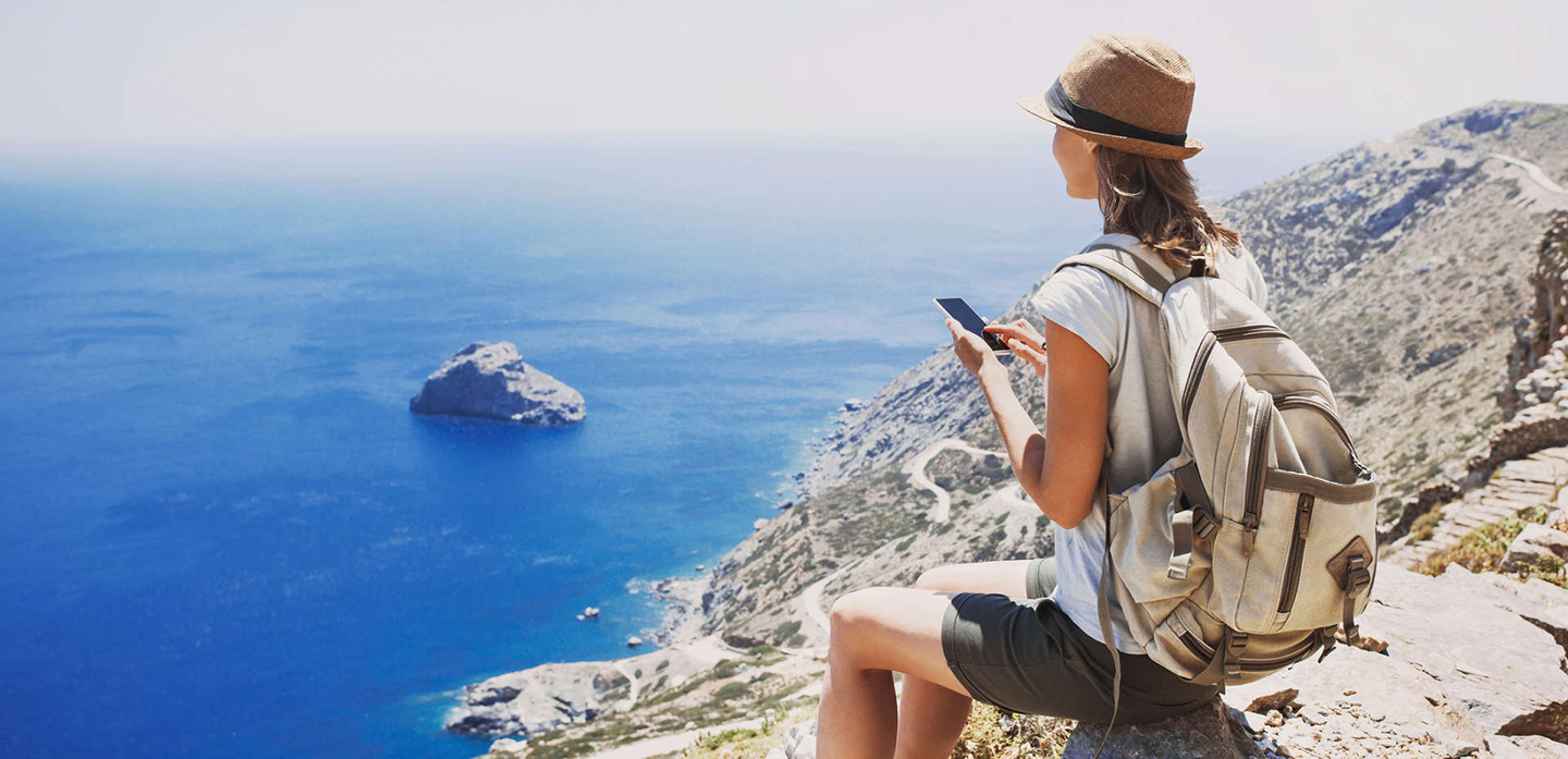 Young woman traveler using smart phone