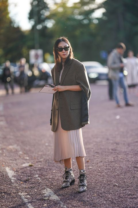 guest-wears-a-blazer-jacket-a-pleated-skirt-snake-print-news-photo-1043739514-1552581283