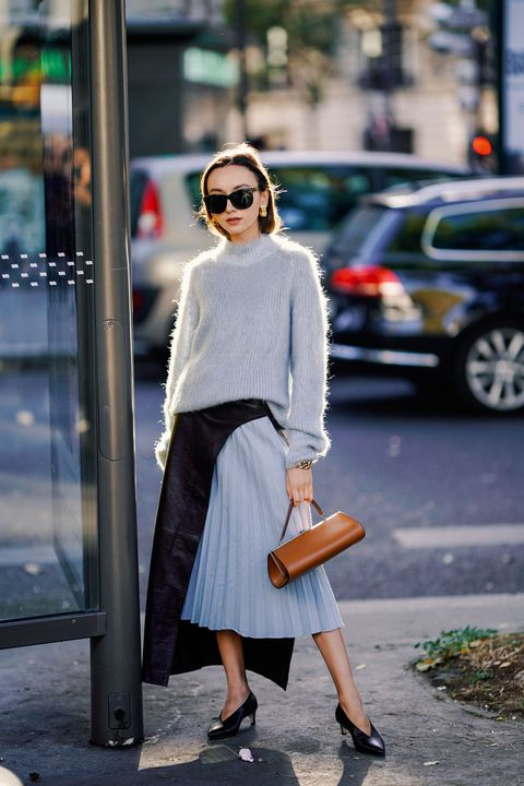 guest-wears-a-wool-pullover-a-pale-blue-pleated-skirt-a-news-photo-1040428506-1552581443